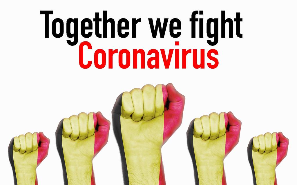 Belgium raised fist with Together we fight Coronavirus text