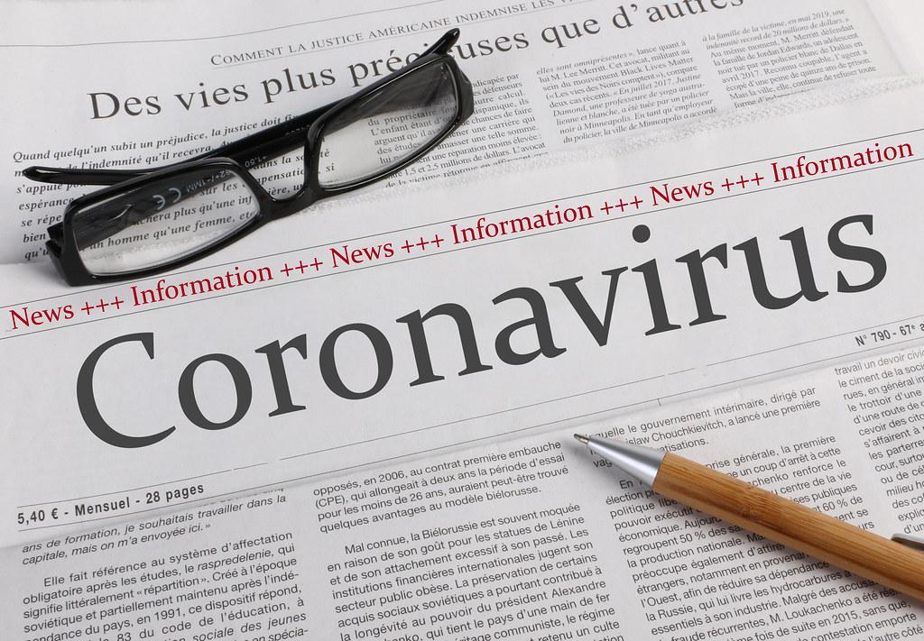 A newspaper with the headline Coronavirus