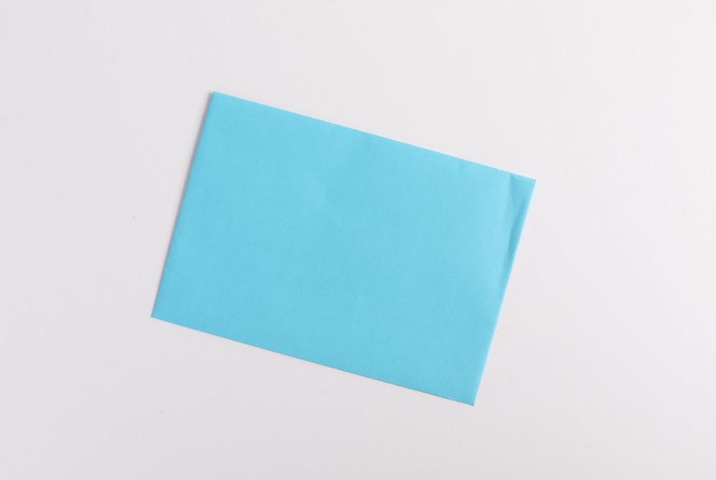 Blue envelope on white background