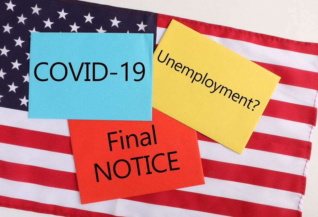 COVID-19 final notices economic and health topics for 2020 American flag on the background