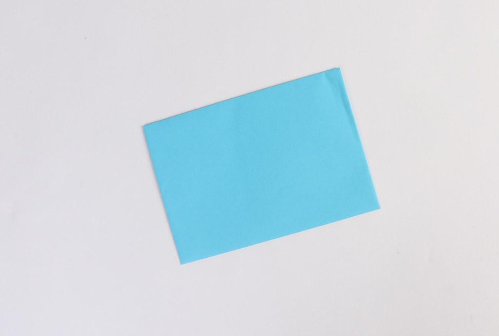 Empty blue envelope on white background