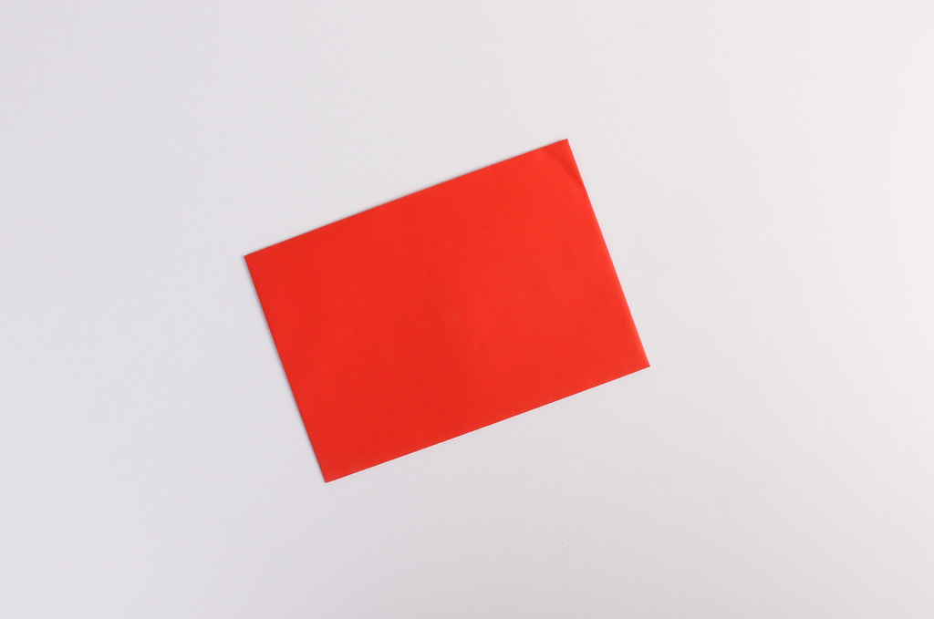 Empty red envelope on white background