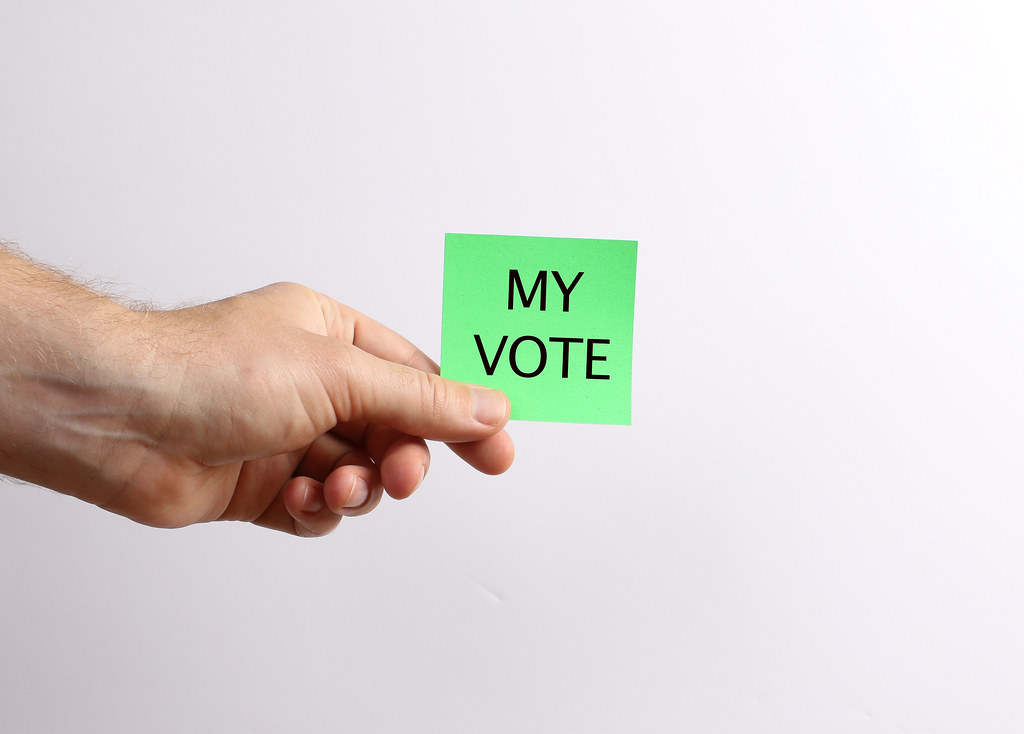 Hand holding green paper with My Vote text