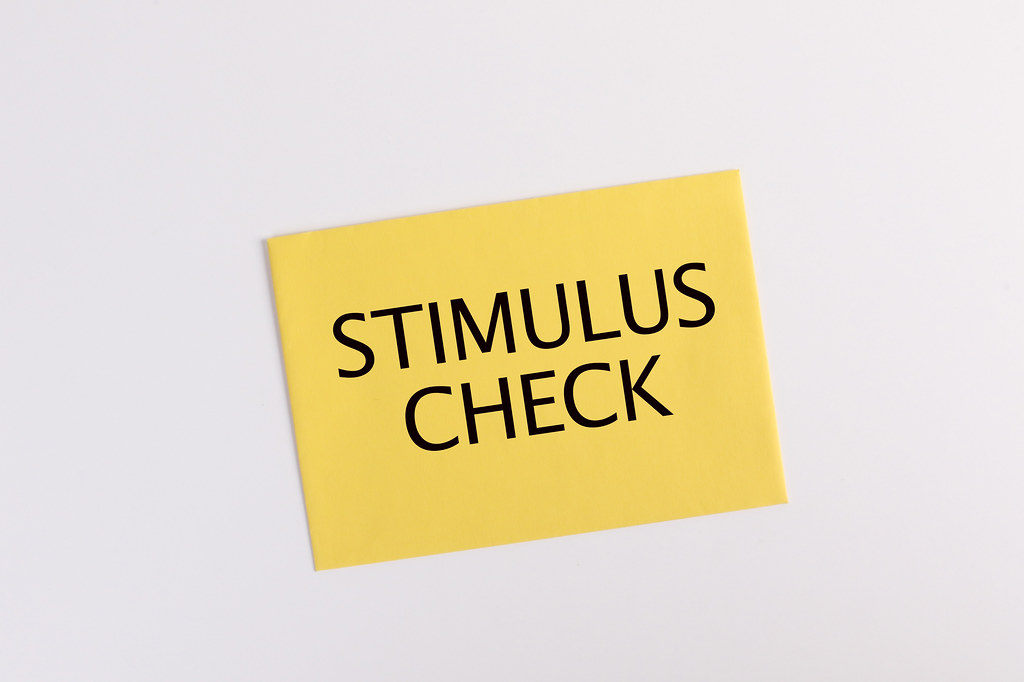 Yellow envelope with Stimulus check text on white background