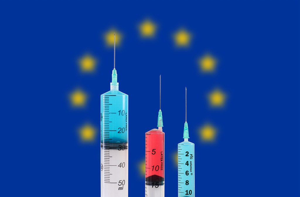 Syringes with the flag of European Union. Vaccination. Pandemic covid-19