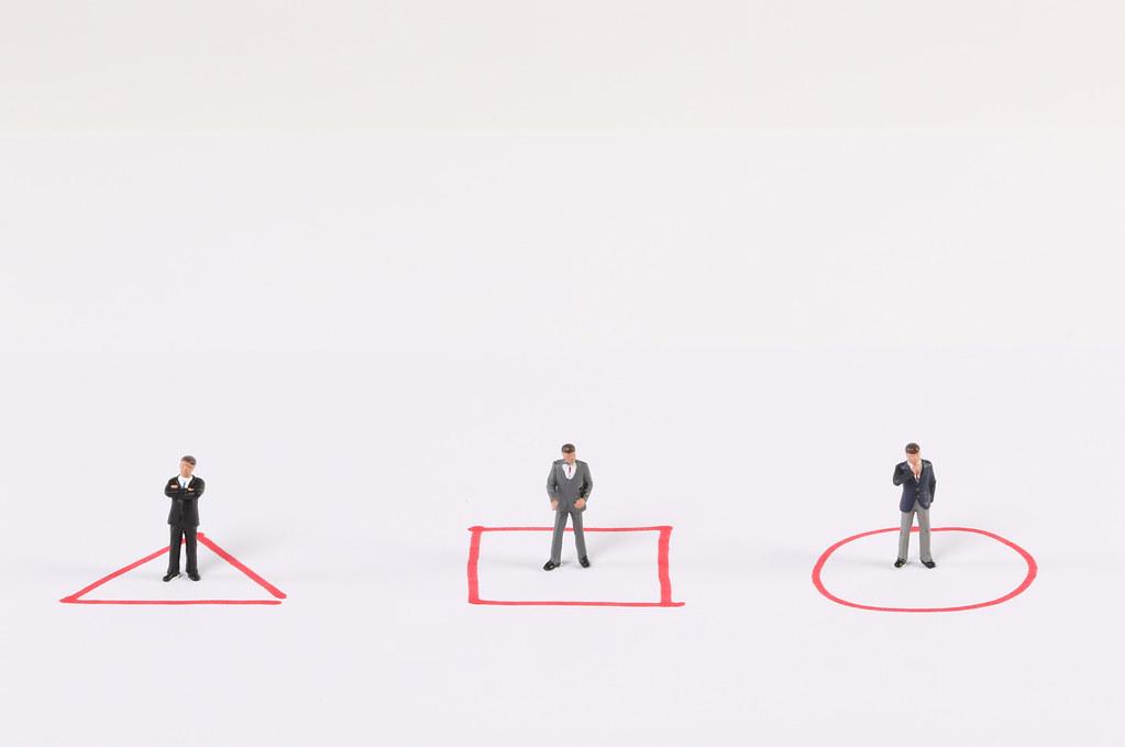 Miniature businessman, management concept