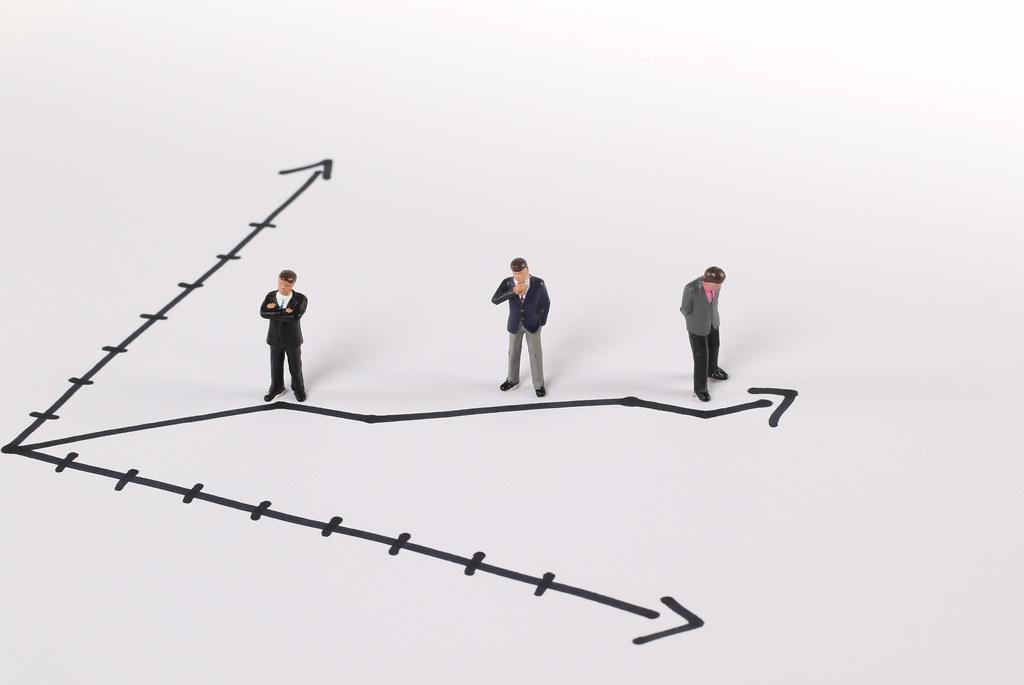 Miniature businessman on a rising graph