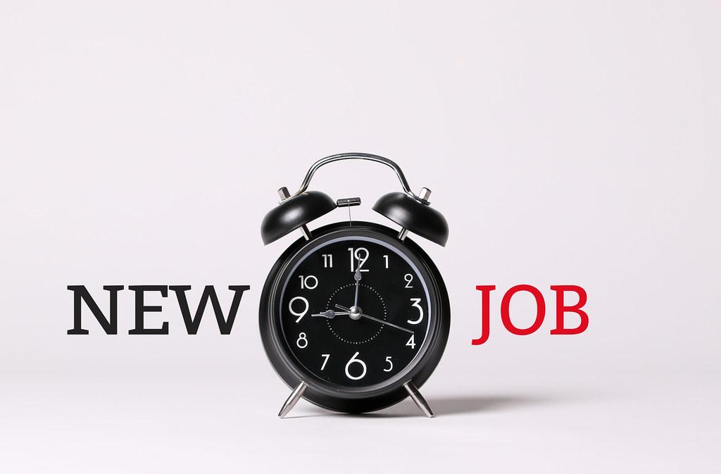 New Job text and black alarm clock concept