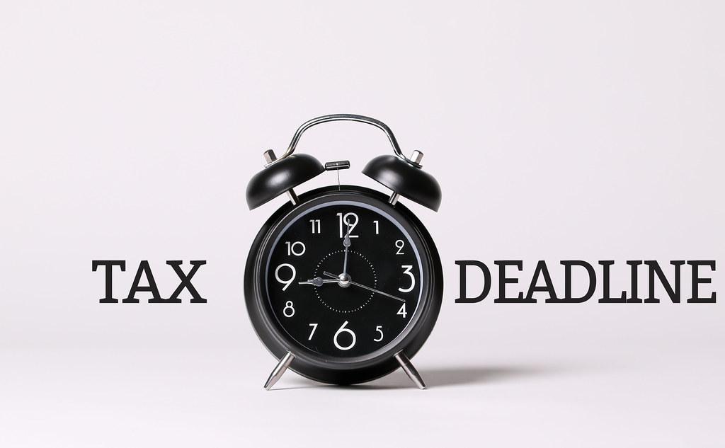 Tax Deadline text and a black alarm clock