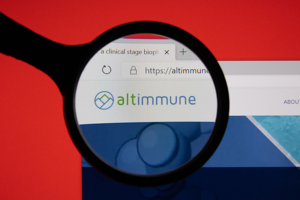 Altimmune website page logo on laptop display with red background