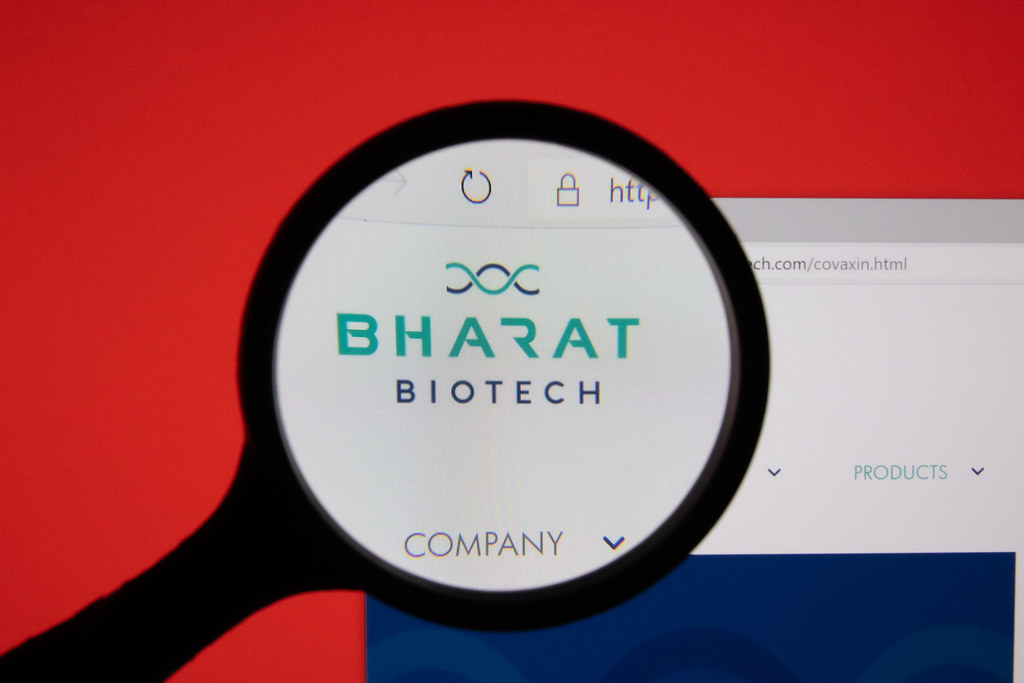 Bharat Biotech company website page logo on laptop display with red background